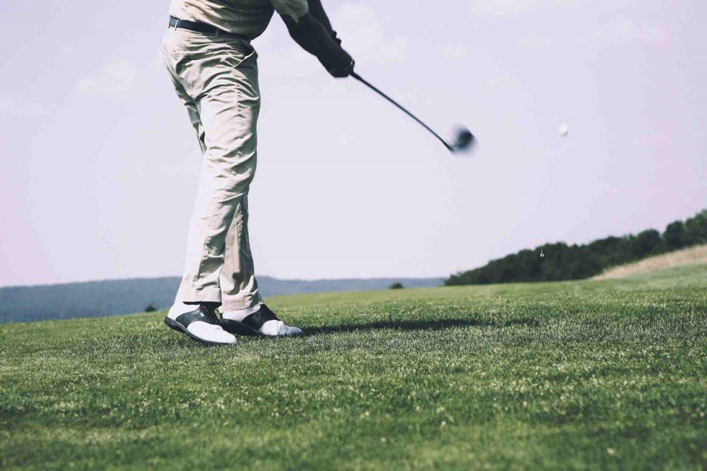 Man golfing on the green
