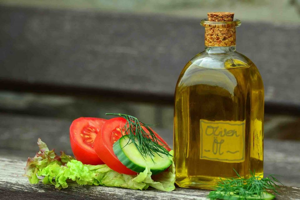 Picture of olive oil and healthy vegetables