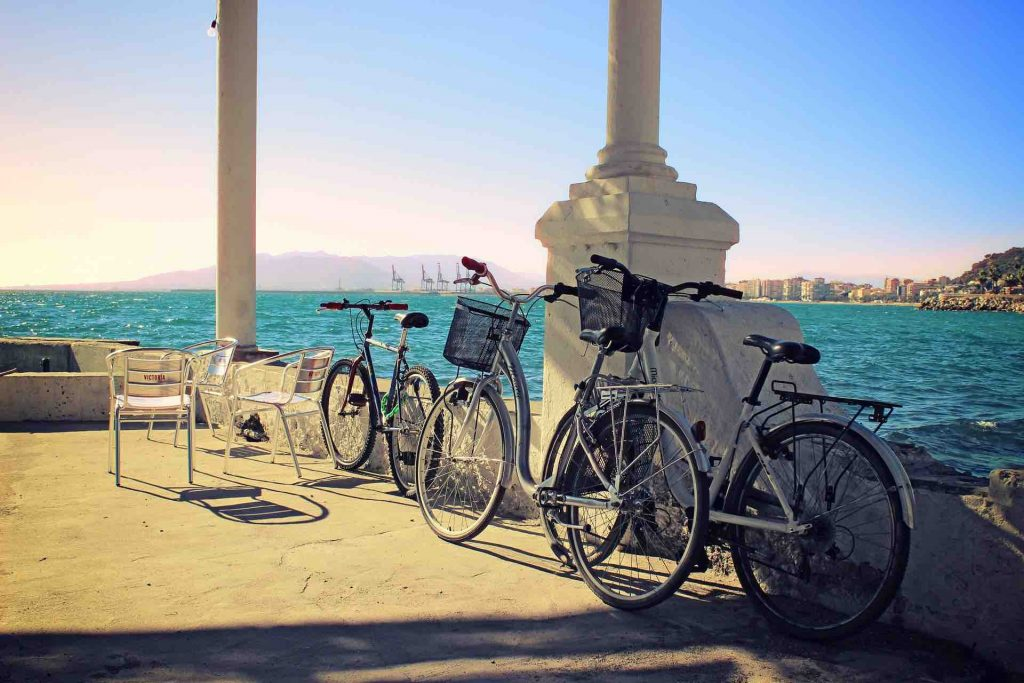 Bicycles lying against a pillar in Spain