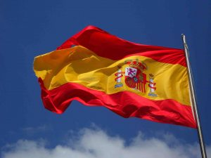 Spain's red and yellow flag fluttering in the wind
