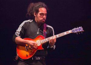 Man playing Spanish reggae music live